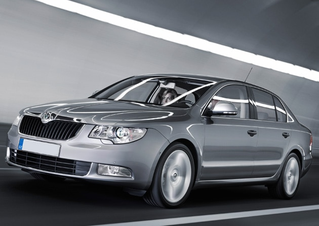 Silver car driving through tunnel